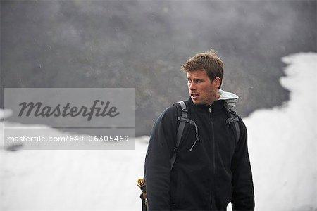 Hiker standing in snowy landscape