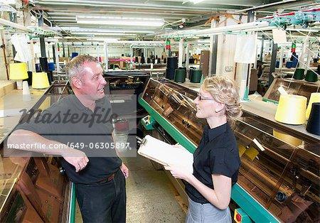 Workers talking in garment factory