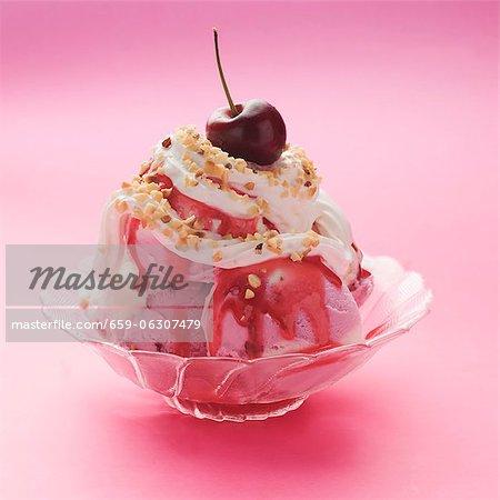 Raspberry and vanilla ice cream with cream and raspberry sauce
