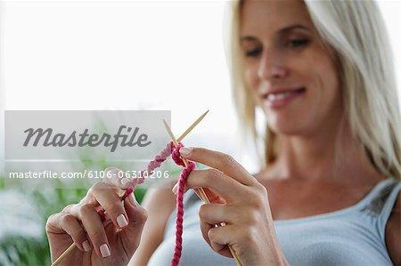 head shot of woman knitting