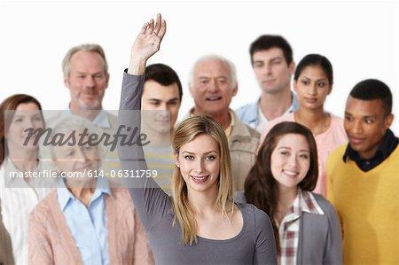 Gruppe von Menschen, Frau mit Arm ausgelöst