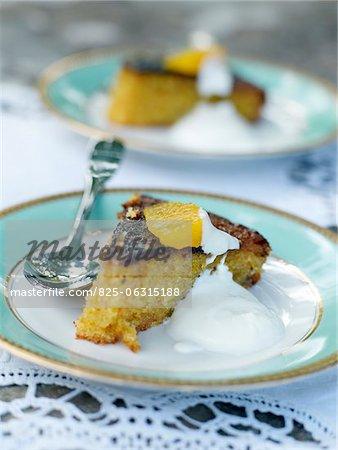 Portion of peach cake with cream