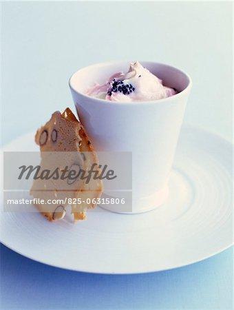 Fresh yoghurt with blackberries and almond tuiles