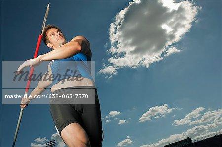 Javelin thrower aiming, low angle view