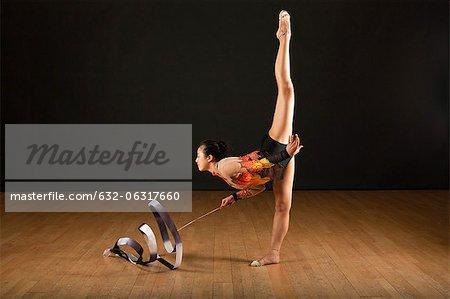 Gymnast performing standing splits