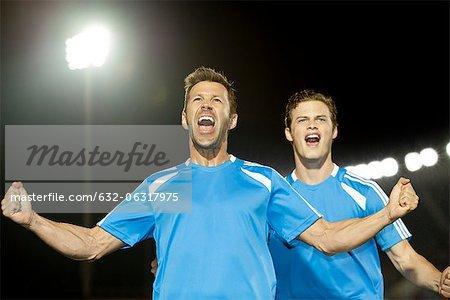Joueurs de foot, fête, portrait