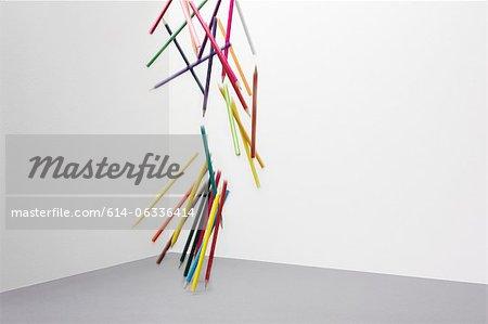 Coloured pencils falling