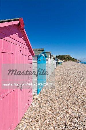 Multicoloured beach huts at Seaton, a small seaside town on the Devon Heritage Coast, Jurassic Coast, UNESCO World Heritage Site, Devon, England, United Kingdom, Europe