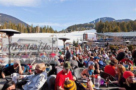 Visitors enjoying apres ski at an outdoor patio, Whistler Blackcomb Ski Resort, Whistler, British Columbia, Canada, North America