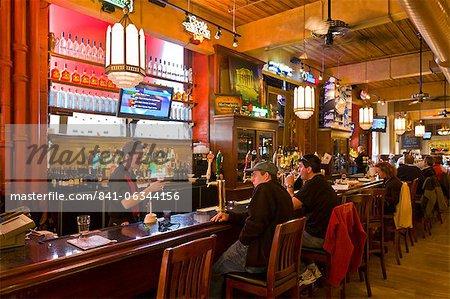 Patrons enjoying a drink at a pub, Toronto, Ontario, Canada, North America