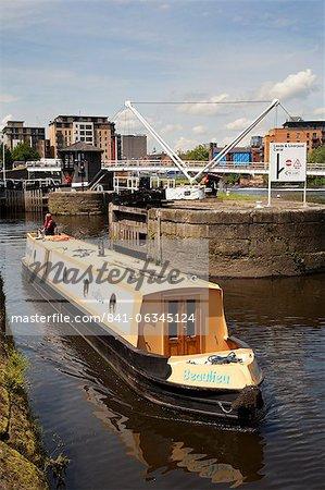 Narrowboat navigating Leeds Lock No 1 Aire and Calder Navigation, Leeds, West Yorkshire, Yorkshire, England, United Kingdom, Europe