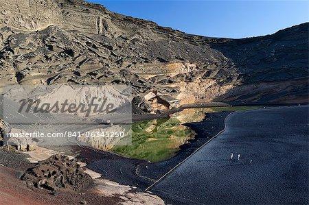 Lagoon and lava cliffs, El Golfo, Lanzarote, Canary Islands, Spain