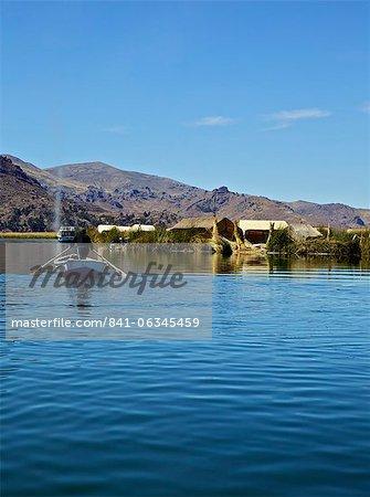 Aymara man in a boat, Lake Titicaca, Flotantes, peru, peruvian, south america, south american, latin america, latin american South America