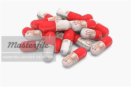 Pilules décorés de billets en euros