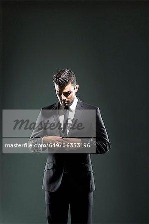 Businessman buttoning suit jacket