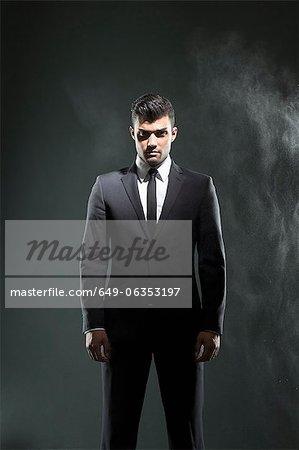 Businessman standing in smoky room