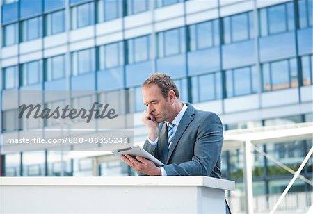 Businessman using Tablet PC, Niederrad, Frankfurt, Germany