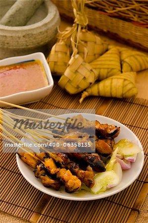 satay and malaysian foods on lowlight setup