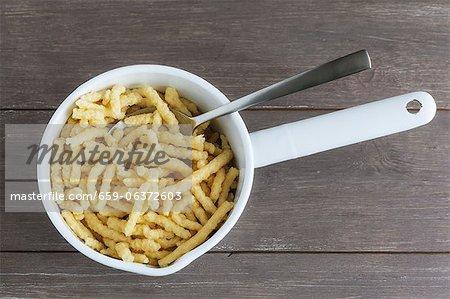 Spätzle (soft egg noodles) in a saucepan