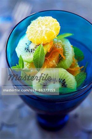 Fresh Kiwi, Orange and Mint Salad in a Blue Glass