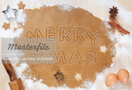 Cookie-Teig gerollt mit Merry x-mas hinein geschnitten