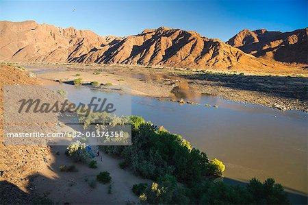 Camping on sandy bank of river, Orange River, Richtersveld National Park, Karas Region, Namibia