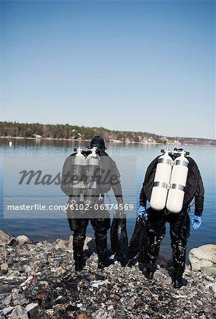Two men preparing for diving