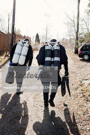 Two divers walking
