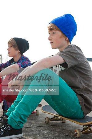 Boys Sitting on Skateboards, Mannheim, Baden-Wurttemberg, Germany
