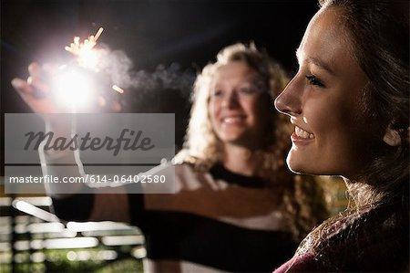 Friends holding sparkler