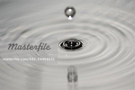 Drop hitting surface of water