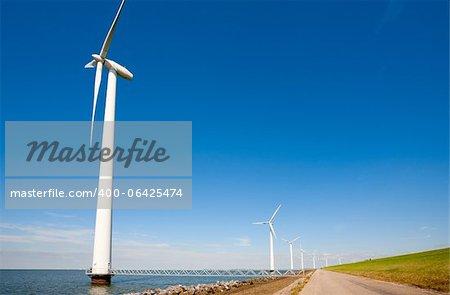 Wind turbines along the dike in the IJsselmeer in Flevoland, the Netherlands