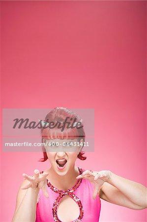 Portrait of Woman Wearing Devil Horns Mimicking a Big Cat