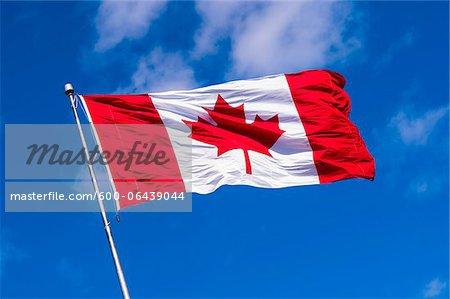 Canadian Flag Waving against Blue Sky, Halifax, Nova Scotia, Canada