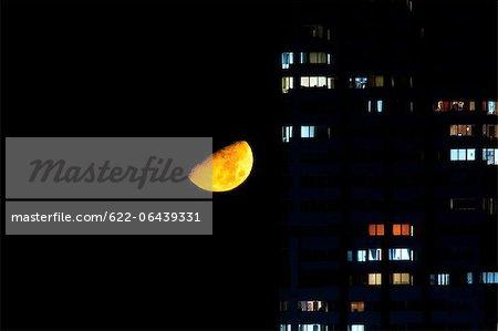 Half moon and apartment lights