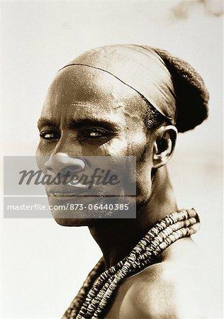 Portrait of Himba Man Wearing Beads around Neck, Namibia
