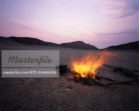 Campfire near Messum Crater at Dusk, Brandberg, Namibia, Africa