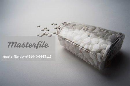 Bottle of aspirin spilling