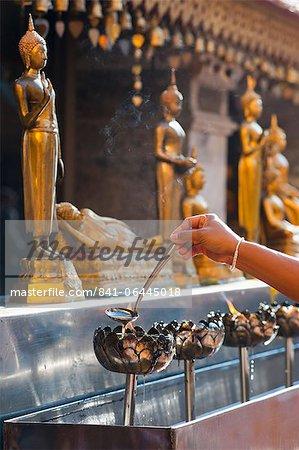 Buddhist person praying, Wat Doi Suthep Temple, Chiang Mai, Thailand, Southeast Asia, Asia