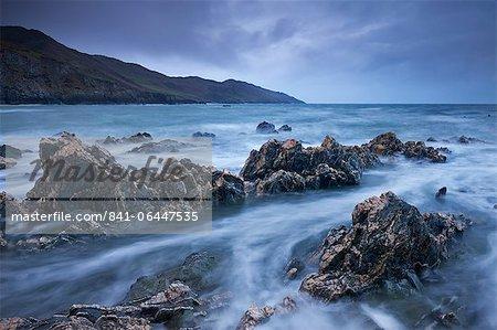 Rocky shores of Rockham Bay, looking towards Morte Point, North Devon, England, United Kingdom, Europe