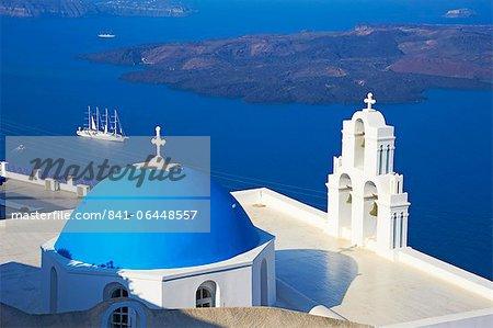 Church with blue dome overlooking the Aegean, Fira, Thira, Santorini, Cyclades, Greek Islands, Greece, Europe