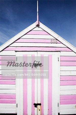 Pink and white striped beach hut, Felixstowe, Suffolk, England, United Kingdom, Europe