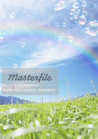 Wind power generators, a rainbow, and soap bubbles