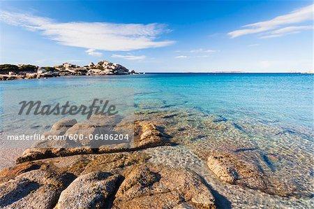 Rock Formation by the Azur Blue Mediterranean Sea, Spiaggia la Licciola, Gallura, Province of Olbia-Tempio, Sardinia, Italy
