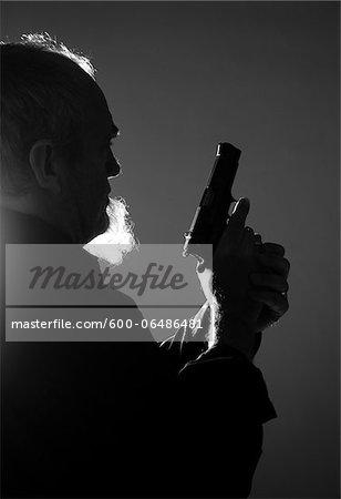 Backlit Man with Gun, Mannheim, Baden-Wurttemberg, Germany