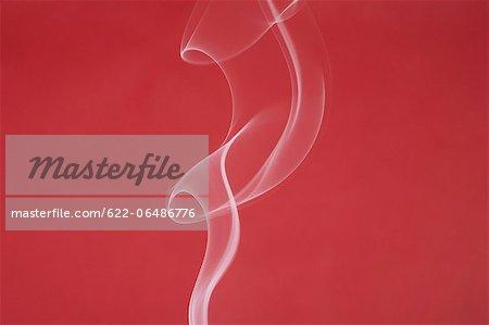 White smoke on red background