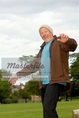 Older man walking outdoors