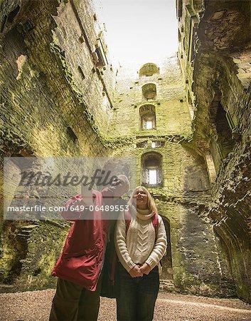 Couple exploring medieval castle