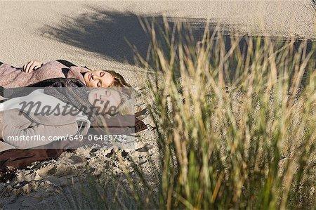 Women napping on beach