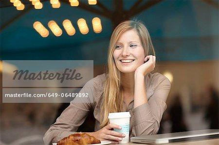 Woman having breakfast in coffee shop